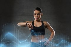 Young woman with heart-rate watch in gym Royalty Free Stock Image