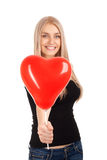 Young woman with heart shape balloon Royalty Free Stock Images