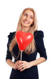 Young woman with heart shape balloons Stock Photo