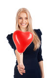 Young woman with heart shape balloons Royalty Free Stock Photography