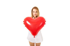 Young woman with heart shaped balloon. Stock Image