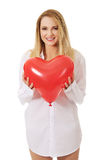 Young woman with heart shaped balloon. Stock Images