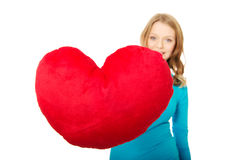 Young woman with heart shaped pillow Royalty Free Stock Photo