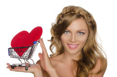 Young woman with heart in shopping cart Royalty Free Stock Image