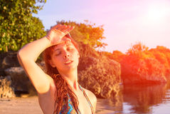 Young woman with heatstroke. Dangerous sun. Beach life. Girl under sun. Sunstroke on hot beach. Young woman with heatstroke. Health problem on vacation Stock Photos
