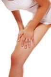 Young woman heaving leg injury Royalty Free Stock Photos