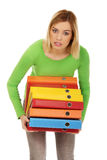 Young woman with heavy binders. Overloaded woman with heavy binders Stock Photos