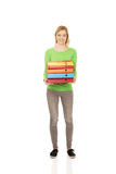 Young woman with heavy binders. Royalty Free Stock Photo
