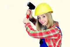 Young woman with helmet and hammer Royalty Free Stock Photo