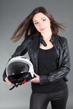 Young woman with helmet in hands Royalty Free Stock Image