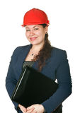 Young woman in helmet holding laptop Stock Images