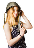 Young woman in helmet holding old vintage gun Stock Images