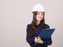 Young woman in helmet records customer's needs Stock Photography