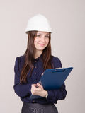 Young woman in helmet records customer's needs Stock Image