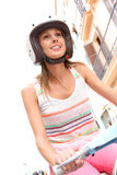 Young woman with helmet riding scooter Stock Photography