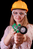 Young woman in helmet with toy bazooka Stock Images