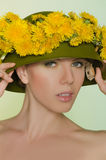 Young woman in helmet with a wreath of dandelions Stock Photos