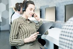 Young Woman in Help Desk royalty free stock photo