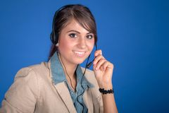 Young woman at the helpdesk Royalty Free Stock Image