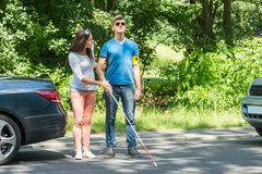 Young Woman Helping Blind Man Royalty Free Stock Photography
