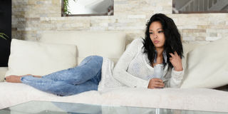 Young woman in her apartment Royalty Free Stock Photography