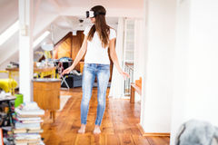 Young Woman In Her Apartment, Using Vr Glasses Stock Images
