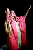 Young Woman With her Arms Lifted in Praise Stock Photo