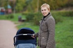 Young woman with her baby Royalty Free Stock Images