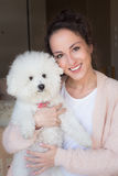 Young woman with her bichon frise. Stock Image