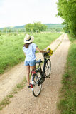 Young woman with her bike Stock Photos
