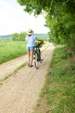 Young woman with her bike Royalty Free Stock Photo