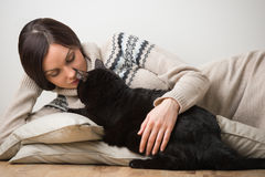 Young woman with her black cat Stock Photography