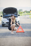 Young woman with her broken car Royalty Free Stock Photo