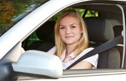 Young woman in her car Stock Photography