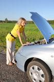 Young woman in her car breaks down. Engine failure Stock Photography