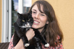 Young woman and her cat Royalty Free Stock Photos