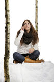 Young woman on her cell phone in the snow Stock Photo