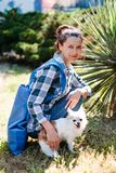 Young woman with her Chihuahua dog on walk stock photos