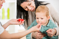 Young woman and her child at the doctor homeopaths Stock Photography