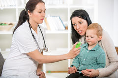 Young woman and her child at the doctor homeopaths Stock Images