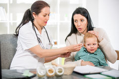 Young woman and her child at the doctor homeopaths Royalty Free Stock Photos
