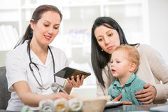 Young woman and her child at the doctor homeopaths Royalty Free Stock Images