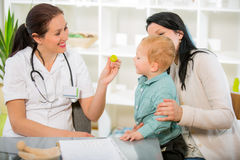 Young woman and her child at the doctor homeopaths. Stock Images