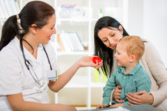 Young woman and her child at the doctor homeopaths. Royalty Free Stock Image