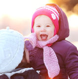 Young woman with her child outdoor in winter Stock Photo