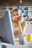A young woman at her computer Stock Photography