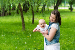Young woman and her cute baby girl outdoor Royalty Free Stock Photo