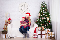 Young woman and her daughter with christmas gift boxes and chris Stock Photo