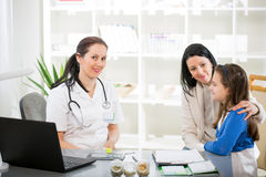 Young woman and her daughter at the doctor homeopaths Stock Image