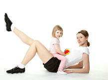 Young woman and her daughter doing sport exercises Royalty Free Stock Images